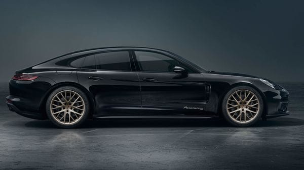 The 21-inch satin-gloss White Gold Metallic wheels and the 'Panamera 10' logos on the front doors make the special edition stand out.
