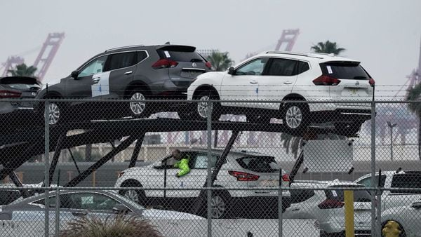 New Nissan Motor Co. Rogue vehicles sit on a car carrier trailer inside an automotive processing terminal at the Port of Los Angeles in Wilmington, California. (Bloomberg)