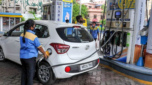 An employee fills fuel in a vehicle at a filling station on Monday (June 15). (PTI)