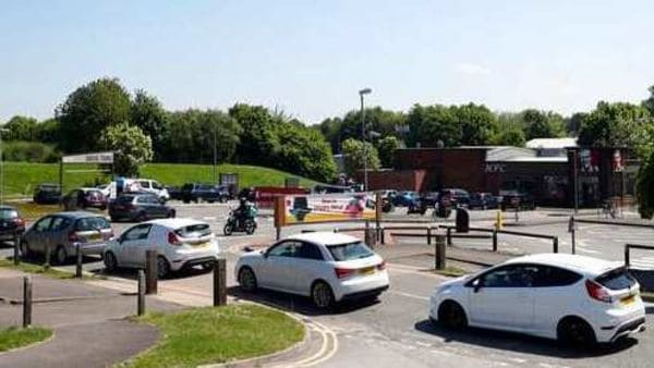 Drivers queue in their vehicles at a KFC restaurant in Basingstoke, Hampshire. (Image used for representational purpose) (AP)