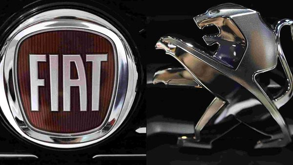 This combination of file pictures created on October 31, 2019 shows the logo of Italian auto maker Fiat (L) in a cars dealer on January 12, 2017 in Saluzzo, near Turin, and the Peugeot logo pictured at the 2014 Paris Auto Show on October 3, 2014 in Paris. (AFP)