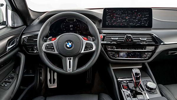 The interior of the 2021 M5 Sedan is highlighted by the standard Live Cockpit Professional with iDrive 7, a 12.3-inch digital instrument display and a 12.3-inch digital central touchscreen central information display. Standard navigation, Apple CarPlay Compatibility and Android Auto Compatibility are included.