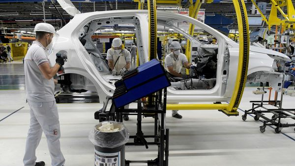 FILE PHOTO: Fiat Chrysler Automobiles assembly workers build a 2020 Argo model, amid the spread of the coronavirus disease. (REUTERS)