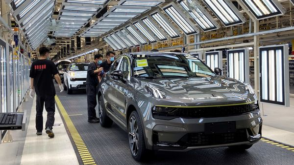 File photo: Employees wearing face masks following the coronavirus disease (COVID-19) outbreak work on a Lynk & Co car production line at Geely's Yuyao plant in Ningbo city, Zhejiang province, China. (REUTERS)