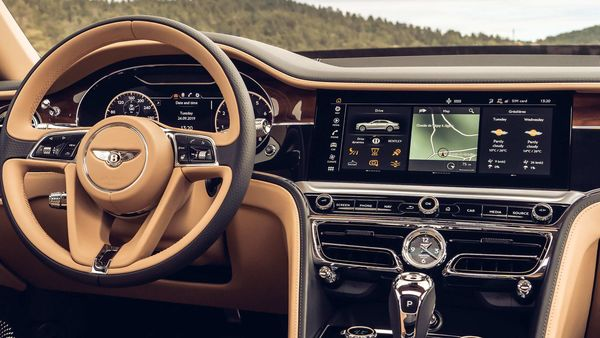 The Display placed on the dashboard can rotate to reveal one of three different sides; a 31.2cm Infotainment touchscreen, classic analogue dials or elegant veneer.