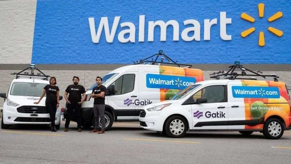 Gautam Narang, CEO and co-founder of self-driving startup Gatik, seen with his fleet in front of a Walmart store. (Photo courtesy: Gatik)