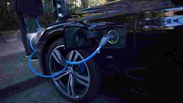 Representational photo of an electric car being charged) (REUTERS)