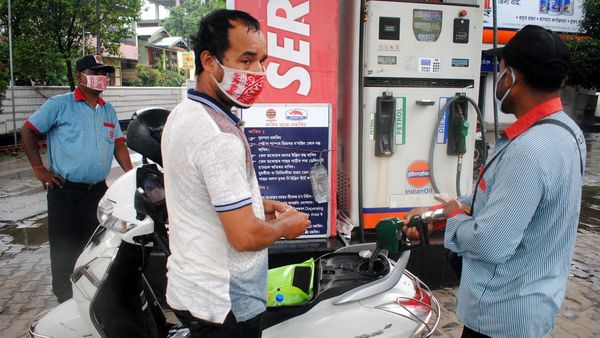 An employee adds fuel in a scooty, at a petrol pump, in Guwahati on Saturday. (ANI Photo)