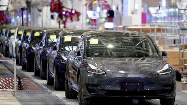 FILE PHOTO: Tesla China-made Model 3 vehicles are seen during a delivery event at its factory in Shanghai, China. (REUTERS)