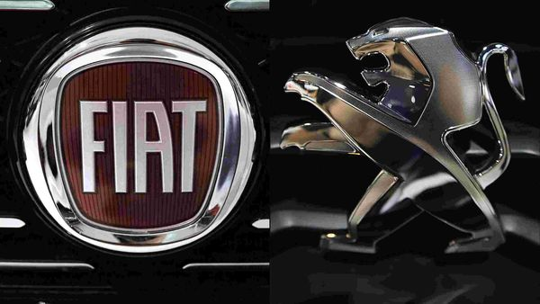 File photo of the logos of Fiat and Peugeot (right).