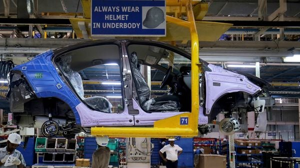 Workers assemble a Tata Tigor car inside the Tata Motors car plant in Sanand, on the outskirts of Ahmedabad, India. (Pre-covid representational photo) (REUTERS)
