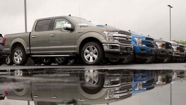 2020 Ford Motor Co. F-150 trucks sit on display at a car dealership in Illinois, US. (Bloomberg)