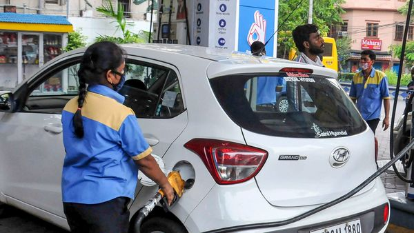 File photo of a pump attendant filling fuel in a car. (PTI)