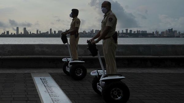 File photo: Police officers patrol on Segways along the promenade at Marine Drive, Mumbai after authorities eased lockdown restrictions. (REUTERS)
