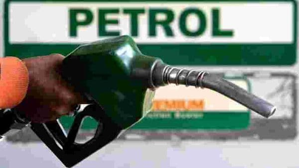 File photo - An attendant holds a petrol nozzle at a petrol pump. (REUTERS)