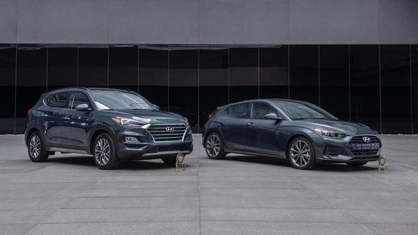 Photo of Hyundai Tucson SUV and Veloster.