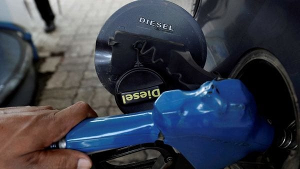File photo - An employee refills diesel on a vehicle at a fuel station in New Delhi. (PTI)
