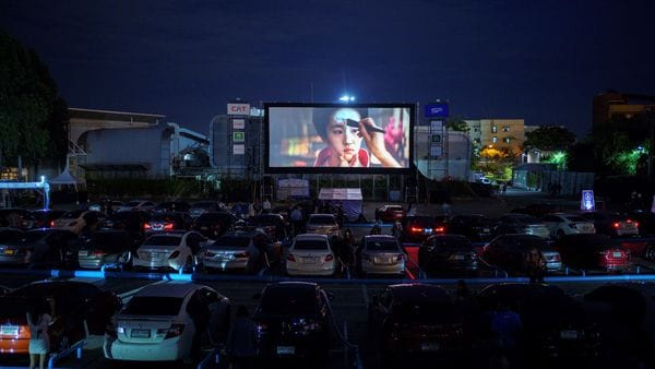Thailand has opened its first drive-in cinema for fans who are wary of coronavirus. It is being operated in a car park in Bangkok. (REUTERS)