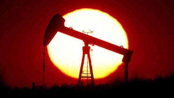 The sun sets behind an oil pump near Paris, France. (REUTERS)