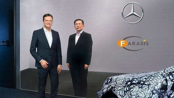Markus Schafer, head of Daimler Group Research,, seen with Yu Wang, Founder and CEO of Farasis Energy.