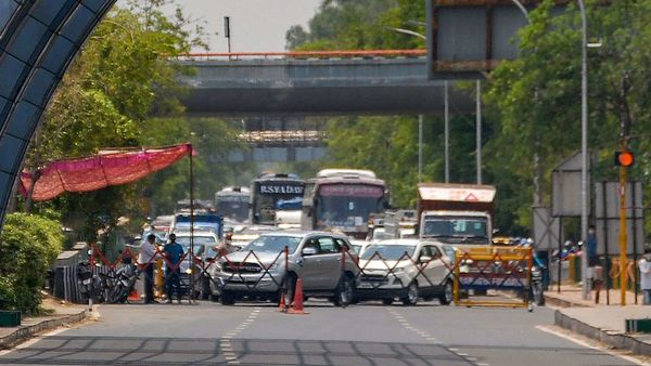 UP Police conduct checking of all the vehicles in Noida moving towards New Delhi. (PTI)