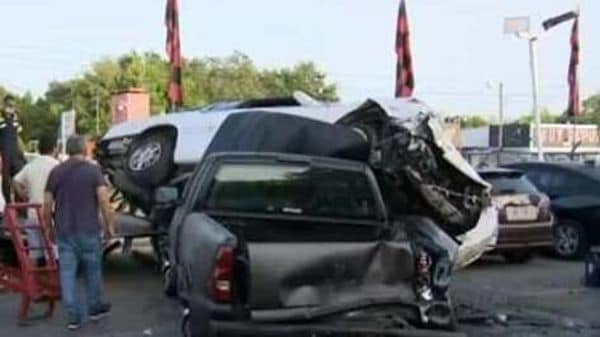 Owner of the dealership assessing the damage done by the crash. Photo courtesy: Screengrab of a YouTube video posted by CBS Miami