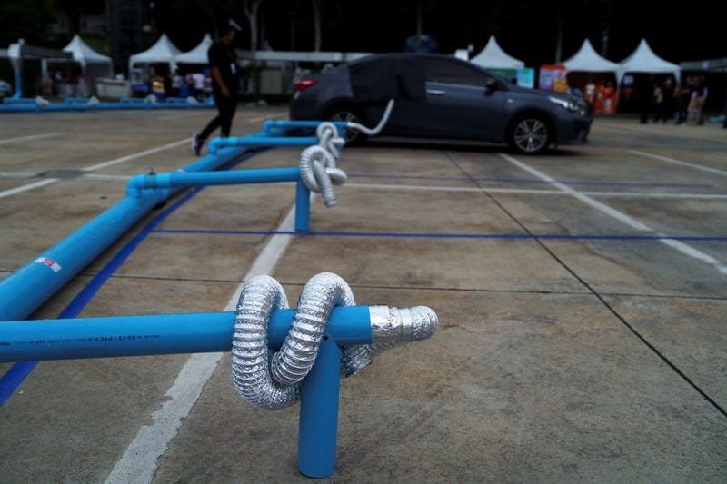 The organisers of the drive-in cinema created a network of plastic pipes in the parking lot connected to dozens of smaller, flexible tubes, to channel cool air into cars through gaps in the windows. (REUTERS)