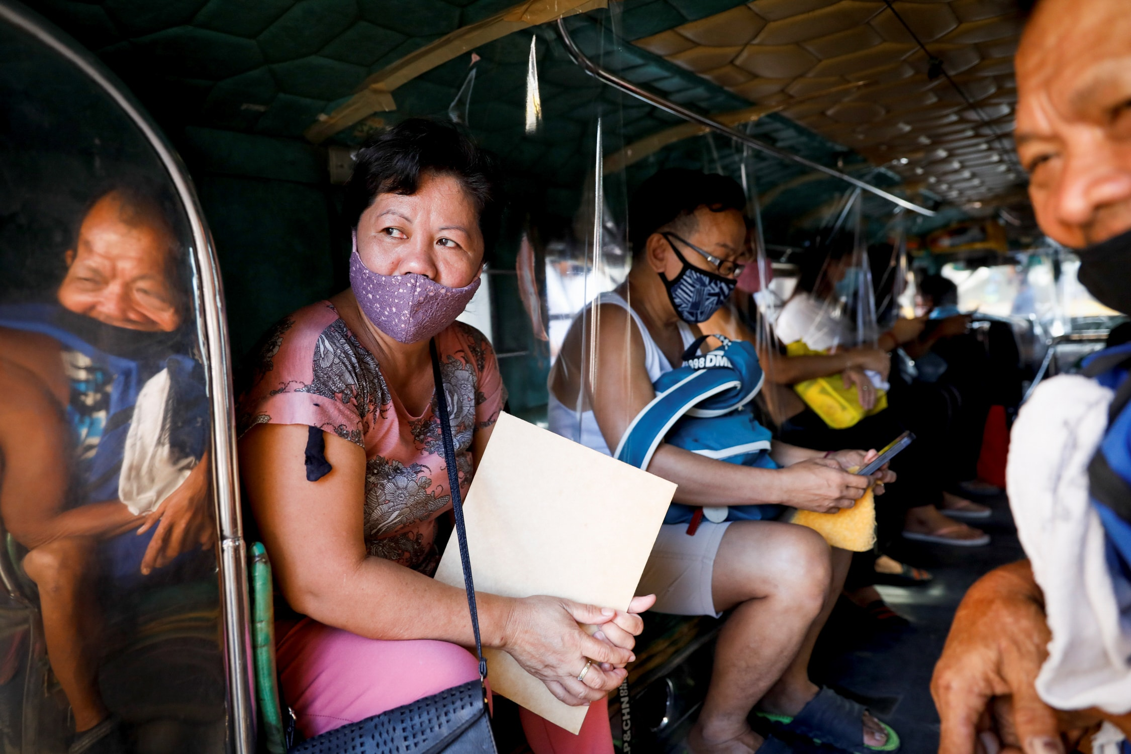 On a typical day in Manila, an estimated 55,000 of these large jeepneys used to crawl through gridlocked roads carrying up to 15 passengers who sat knee-to-knee on twin benches in the windowless vehicles. (REUTERS)