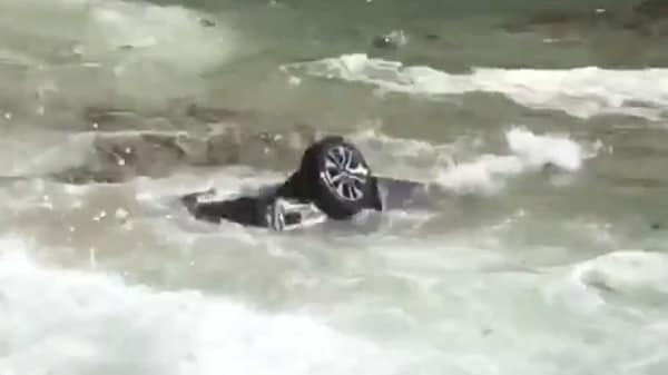 The stolen vehicle being tossed around by waves on the Pacific Ocean. (Photo courtesy: Twitter/CodyS86)