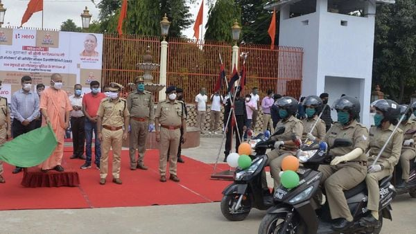 Uttar Pradesh CM Yogi Adityanath flags off a rally of 100 Hero scooters presented to women police officials in the state.