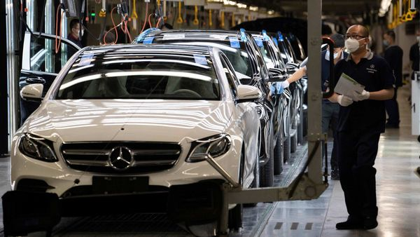 Workers inspect newly assembled cars at a Beijing Benz Automotive Co. Ltd factory, a German joint venture company for Mercedes-Benz, in Beijing. (AP)