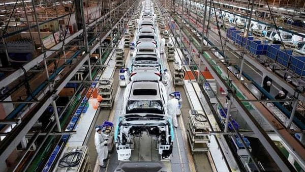 FILE PHOTO: Employees work on a production line inside a Dongfeng Honda factory after lockdown measures in Wuhan, the capital of Hubei province. (REUTERS)