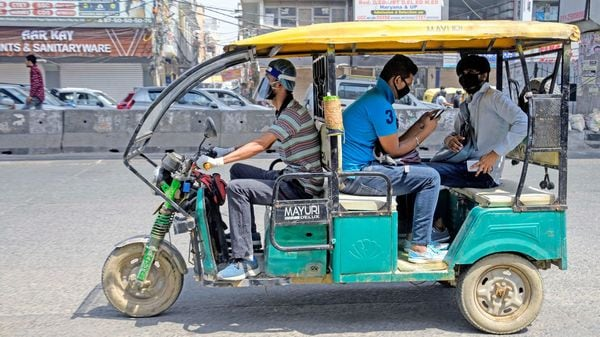 Passengers travel in an e-rickshaw.