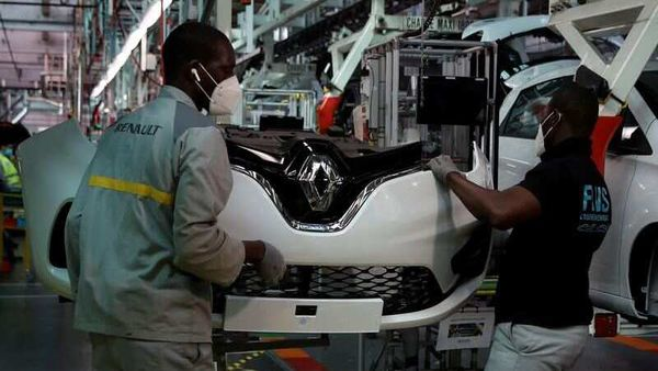 FILE PHOTO: Employees, wearing protective face masks, work on the automobile assembly line of Renault ZOE cars at the Renault automobile factory in Flins. (REUTERS)