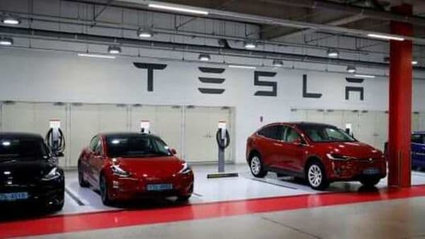 Tesla electric vehicles for test driving are parked in Hanam, South Korea. (REUTERS)