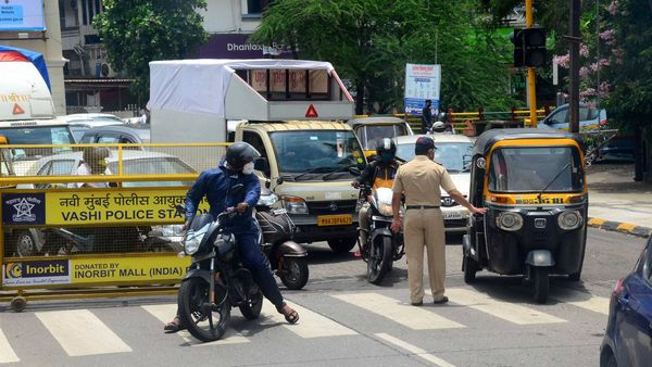 A police constable stops commuters at Vashi during an intensified lockdown by NMMC to curb the spread of coronavirus in Navi Mumbai. (PTI)