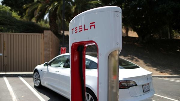 EV makers like Tesla are looking at batteries that offer a big range and require little in terms of maintenance. Supporting infrastructure, like this SuperCharger, is also crucial. (REUTERS)