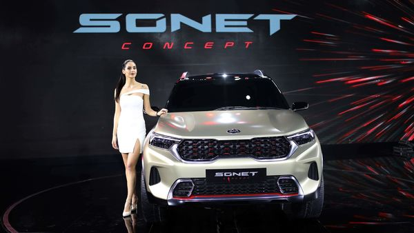 File photo - A model poses next to KIA Sonet Concept car at the Auto Expo in Greater Noida. (AP)