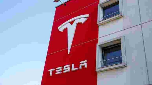 The logo of Tesla is seen at a branch office in Bern, Switzerland March 25, 2020. REUTERS/Arnd Wiegmann/Files (REUTERS)