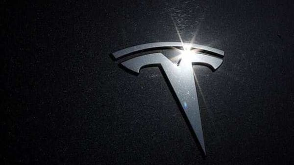 The Tesla logo is seen on a car in Los Angeles, California. (REUTERS)