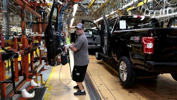 A Ford Motor assembly worker works on a Ford F150 pick-up truck at the Dearborn Truck Plant in Michigan. (File photo) (REUTERS)