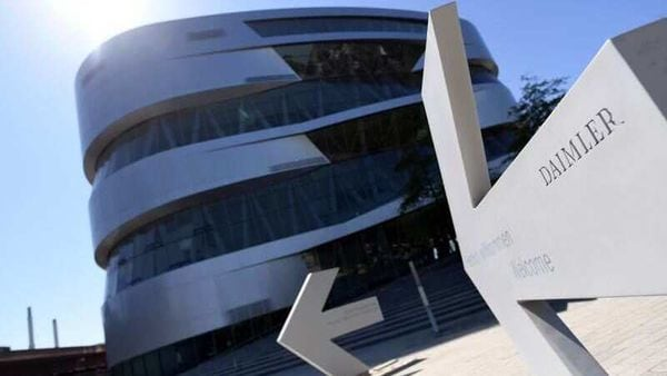 An arrow in front of the Mercedes-Benz Museum shows the way to the Daimler headquarters in Stuttgart, Germany. (REUTERS)