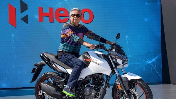 Hero MotoCorp Chairman and Managing Director, Pawan Munjal, unveils the all-new Hero Xtreme 160R bike during Hero World 2020, in Jaipur. (File photo) (PTI)