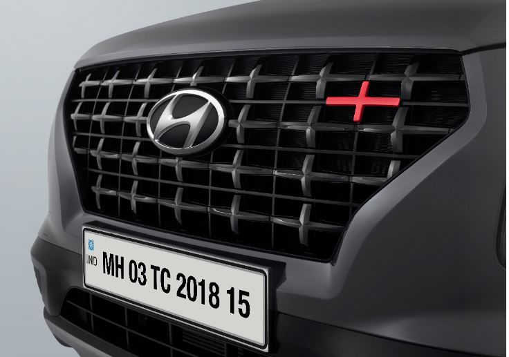 Hyundai Venue Sport trim gets glossy black front grille with red insert, dark grey front bumper garnish, dark grey roof rail with red insert on the outside.