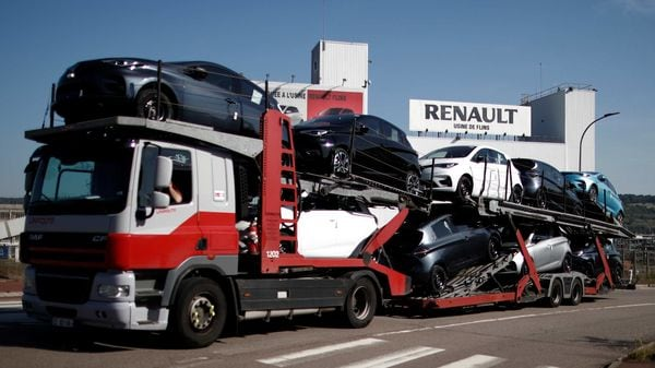 A car carrier transporting Renault ZOE cars leaves the Flins plant of French carmaker Renault in Aubergenville, west of Paris. (REUTERS)