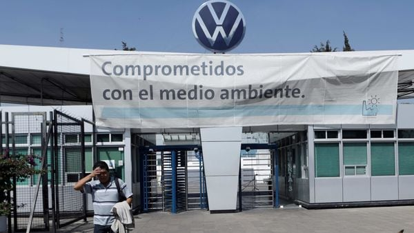 An employee leaves the Volkswagen Puebla plant in Mexico. (File photo) (REUTERS)