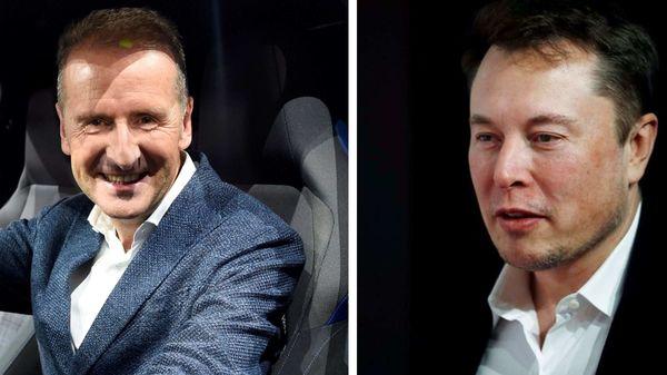 Volkswagen CEO Herbert Diess (L) and Tesla CEO Elon Musk.