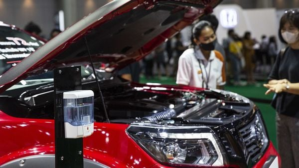 A hand sanitizer dispenser sits next to a vehicle on display at the the Nissan Motor Co. booth at the Bangkok International Motor Show in Bangkok, Thailand, (Bloomberg)