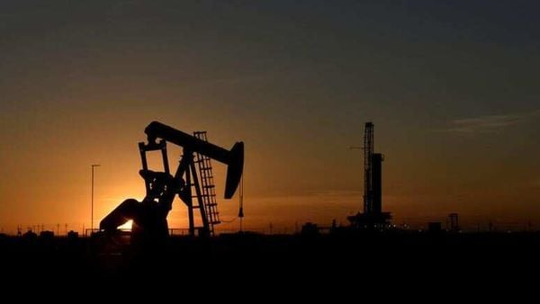 File photo - A pump jack operates in front of a drilling rig at sunset in an oil field in Midland, Texas. (REUTERS)