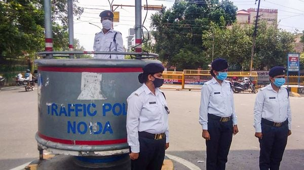 Women personnel on traffic enforcement duty on a road for the first time, in Noida. (PTI)